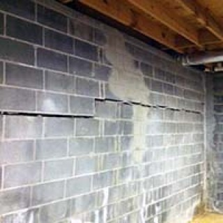 Horizontal cracks like this are actually caused by a bowing wall.  While structural issues like this will scare many homebuyers away, they're often easily repaired.  Credit: Foundation Worx