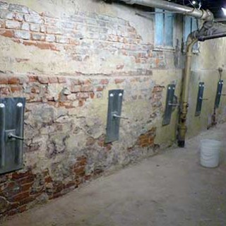 Wall anchors have stabilized this collapsing wall.  Credit: Basement Systems