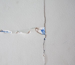 Drywall cracks like this are often minor and not a result of foundation failure.