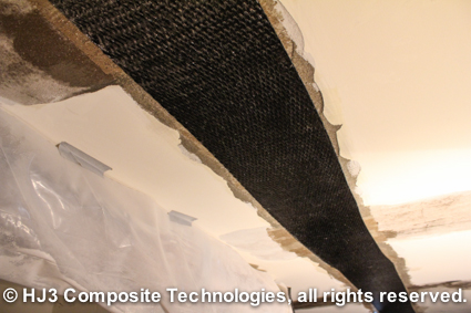 cracked ceiling repaired with carbon fiber